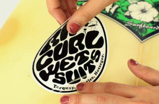 how to put stickers on a surfboard